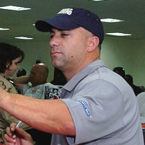 Frank Menechino signing autographs for US troops in Qatar 2007