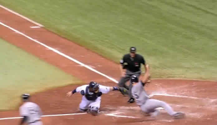 Kevin Kiermaier fields Carlos Beltran's single in center and delivers a strike home to throw out Mark Teixeira on May 14, 2015 at Tampa