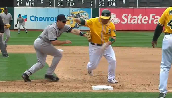 Mark Teixeira snares a liner off the bat of Josh Reddick, then tags Billy Butler to complete the double play at Oakland on May 31, 2015