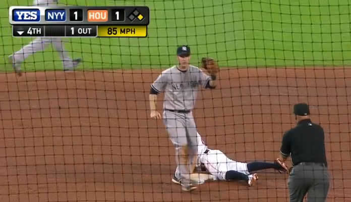 Brian McCann throws out Jose Altuve attempting to steal second base in the 4th inning at Minute Maid Park on June 28, 2015