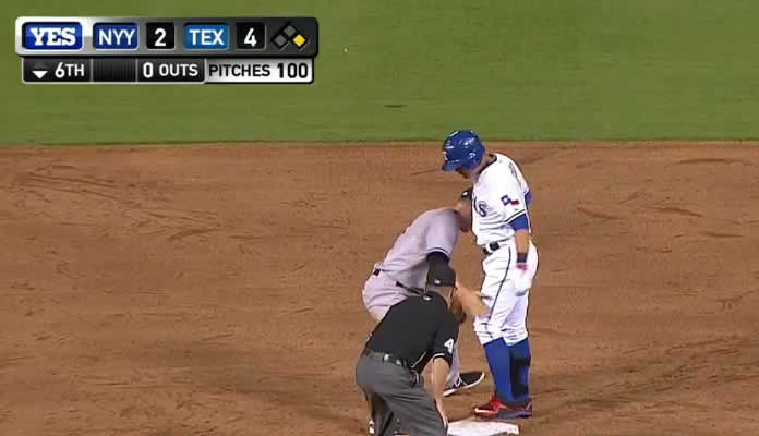 The Yankees challenge a safe call, it is overturned, as Shin-Soo Choo hits to right and Carlos Beltran throws him out at second on July 29, 2015 at Texas