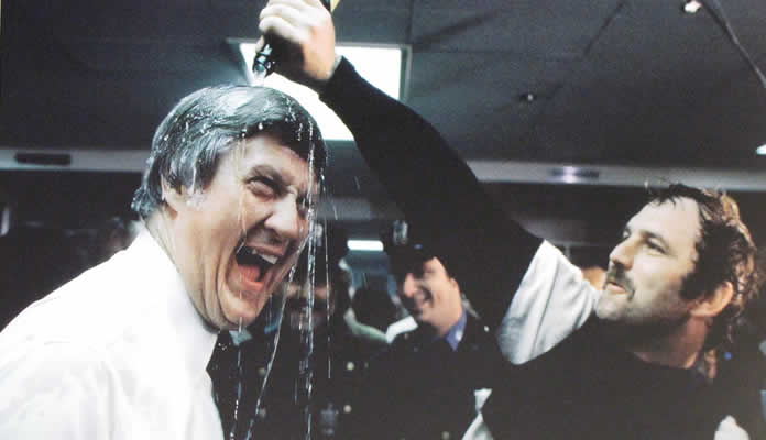 Thurman Munson lays the bubbly on Yankees owner George Steinbrenner after 1978 World Series victory