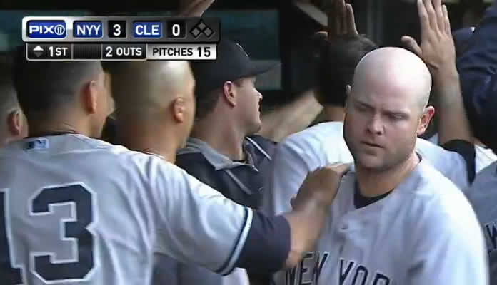 Brian McCann hits a three-run homer just fair, his 20th of the season, to give the Yankees a 3-0 lead at Cleveland on August 13, 2015