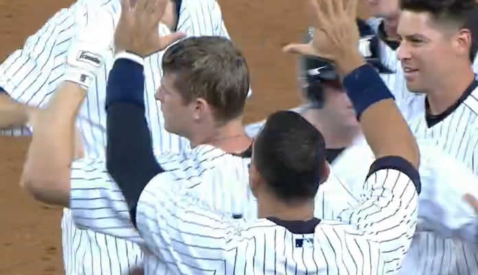 Chase Headley delivers a game-winning groundout to plate Brendan Ryan, giving the Yankees an 8-7 walk-off win in the 10th inning at Yankee Stadium on August 17, 2015