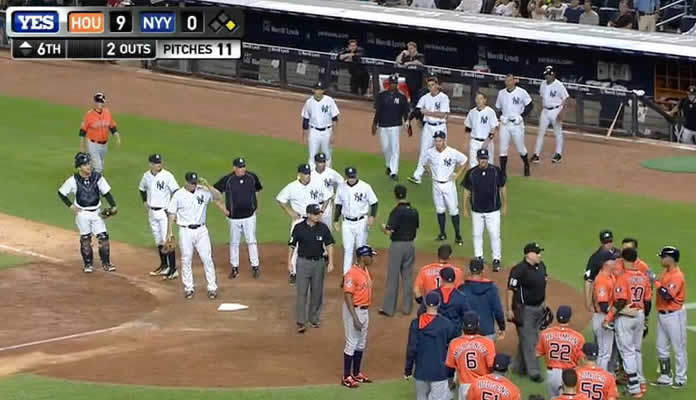 After Carlos Gomez gets emotional near home plate after a flyout, the Astros and Yankees' benches clear on August 25, 2015 at Yankee Stadium