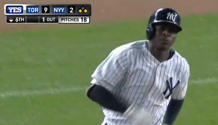 Didi Gregorius launches a three-run home run to right field, cutting the deficit in the bottom of the 6th inning at Yankee Stadium on September 11, 2015