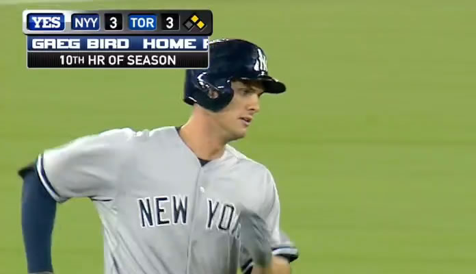 Greg Bird comes up clutch in the 10th, belting a three-run home run to right field to give the Yankees a 6-3 lead at Rogers Centre on September 23, 2015