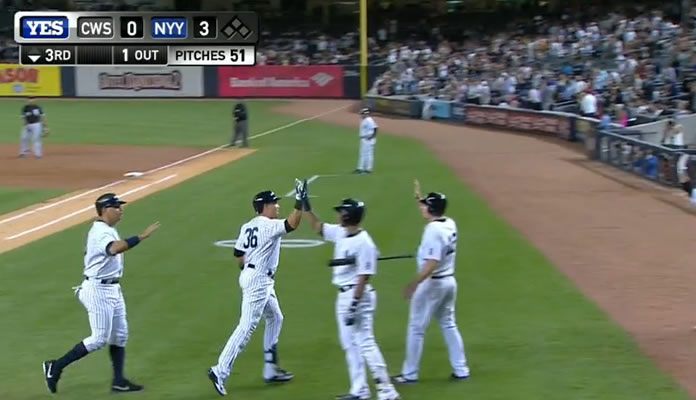 Carlos Beltran belts a three-run homer, which is caught on the fly by a young fan, driving in Alex Rodriguez for his 2,000th run at Yankee Stadium on September 24, 2015
