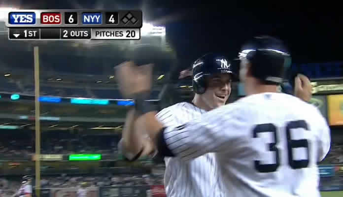 Dustin Ackley drives a two-run home run just over the right-field wall to pull the Yankees within two runs at Yankee Stadium on September 30, 2015